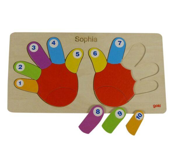 træpuslespil med hænder og tal